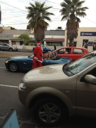 Santa - giving to the cars passing by